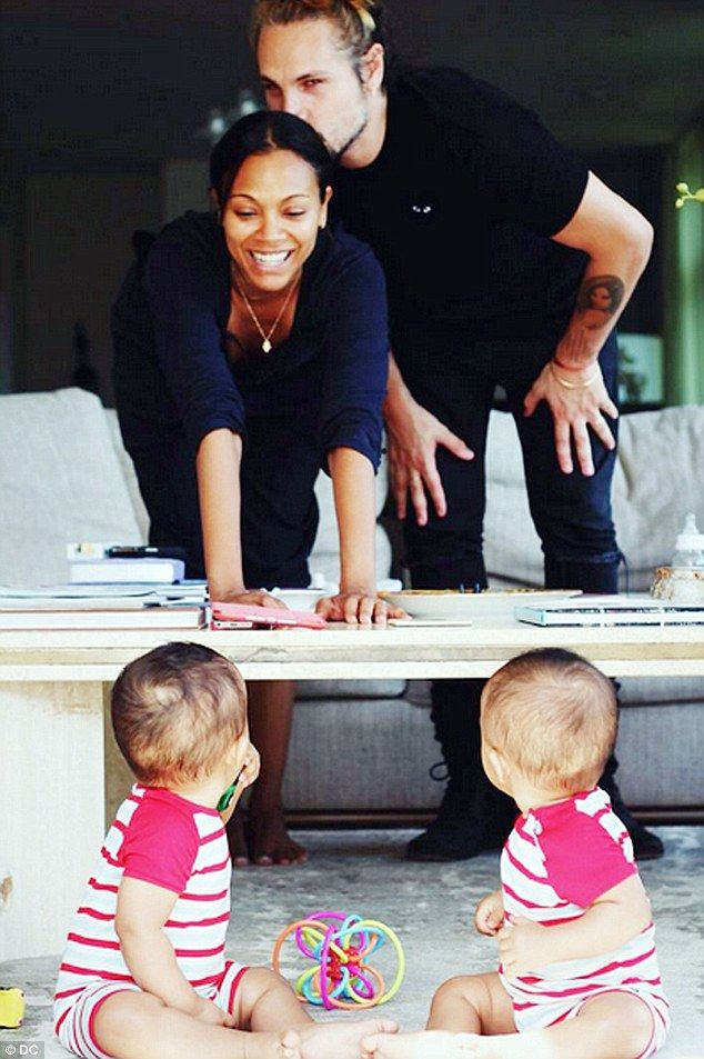 Happy family: The actress shared this photo of her and Marco with their sons to mark National twins Day last month