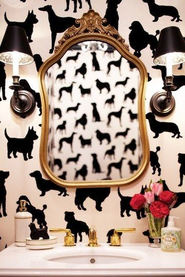 Black and white dog wallpaper in a powder room