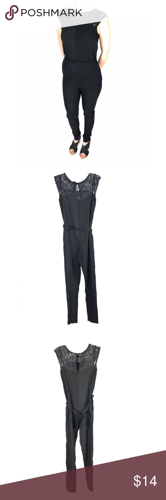 "Black jumpsuit one-piece with lace detail One-piece romper pantsuit, belted at waist, with lace detail at shoulders/cap sleeves. Button closure at neck. Tighter fit from thigh to ankle, looser around waist. 28"" inseam. EUC. Love Tease Pants Jumpsuits & Rompers"