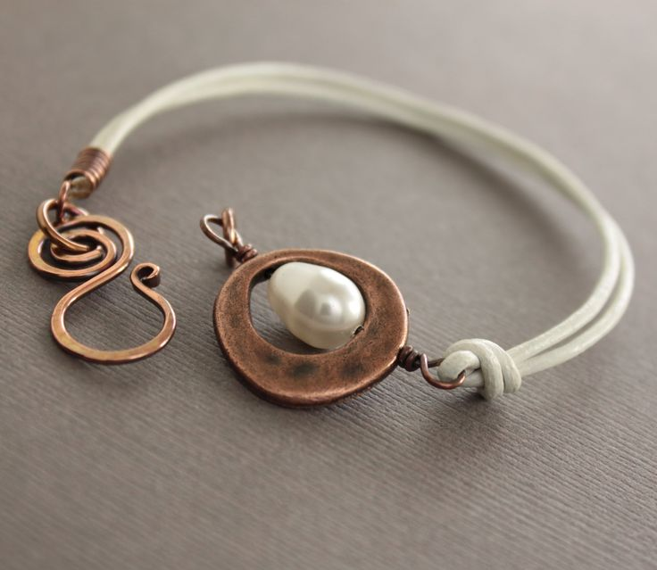 White leather copper bracelet with white Swarovski drop pearl and swan hook clasp - Select your length. $23.00, via Etsy.