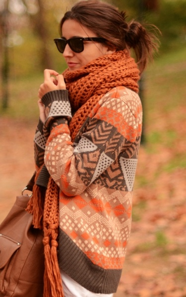 Love that scarf. Cute fall outfit.  #fallfashion #burntorange #orangescarf #scarf #chunky #knit #knitscarf #chunkyscarf #sweater #printedsweater #tan