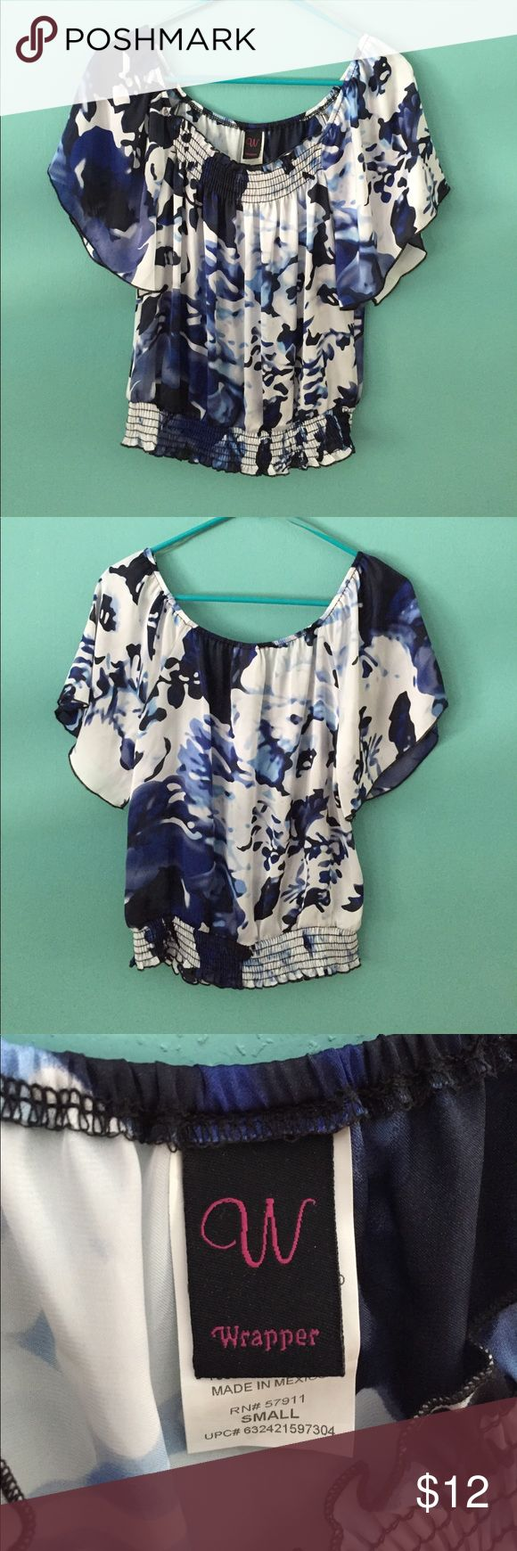 Blue and white blouse Lovely blue and white blouse that would go great with a shirt or pants! Wrapped Tops Blouses