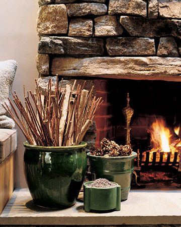 Practical and pretty. Kindling, pine cones and aromatics in planters on the hearth for fall and winter.