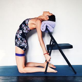 Ustrasana. More stable if chair is placed against wall. More