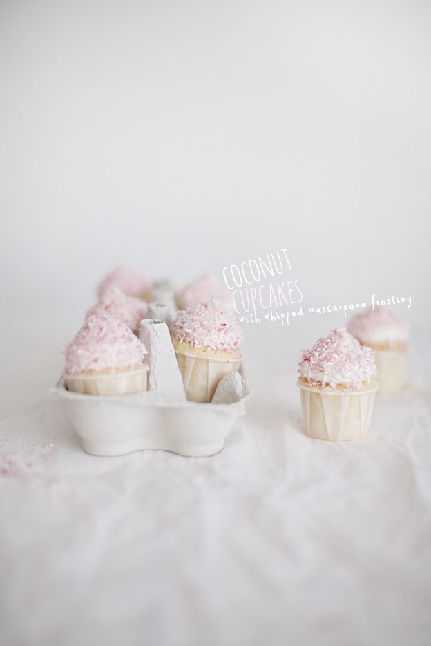 Coconut Cupcakes with Whipped Mascarpone Frosting and pink coconut flakes