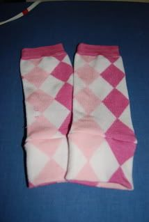"""Homemade baby leg warmers.  I still use """"leg"""" warmers on A's arms, but I have trouble finding non-girly patterns, so I hope to find some solid-color socks and make my own."""