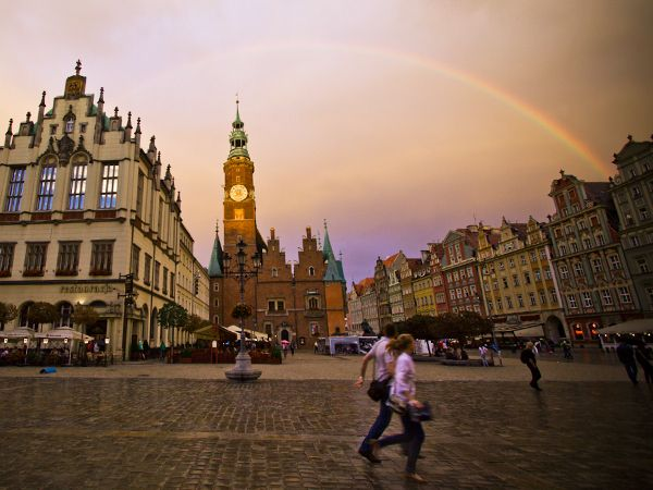 Wrocław, Poland  Photograph by Bella Tozini, My Shot    A rainbow arches over the main square on a summer afternoon in Wrocław's Old Town.