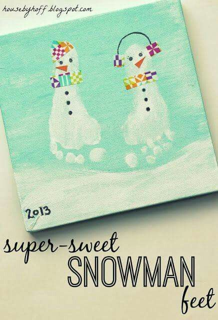 I love these cute snowman feet! Painted foot print Christmas art on canvas.