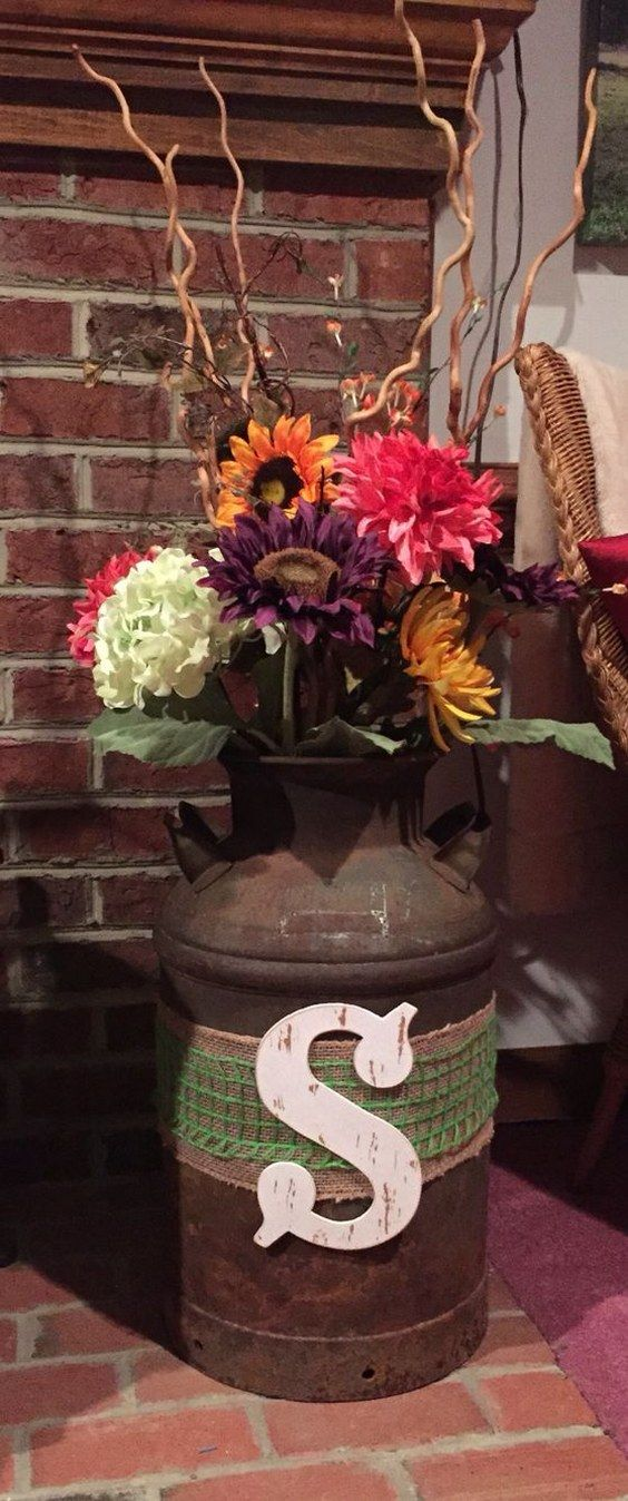 Old milk can w flowers rustic fall wedding decor / http://www.deerpearlflowers.com/rustic-country-milk-jug-wedding-ideas/