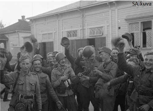 "Finnish soldiers celebrate on the streets of Sortavala shortly after city was liberated by Finnish forces. Soon march song ""Kaarina"" echoed on the streets of the city 1941.08.15"