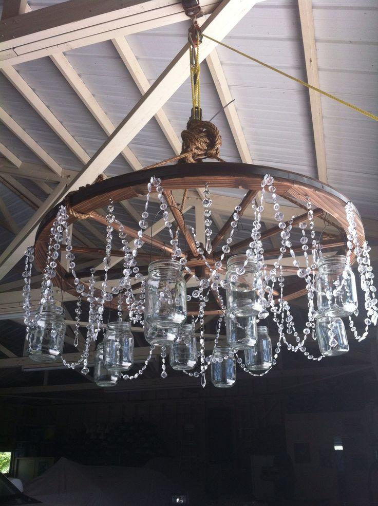 Best 25+ Wheel chandelier ideas on Pinterest | Wagon wheel ...