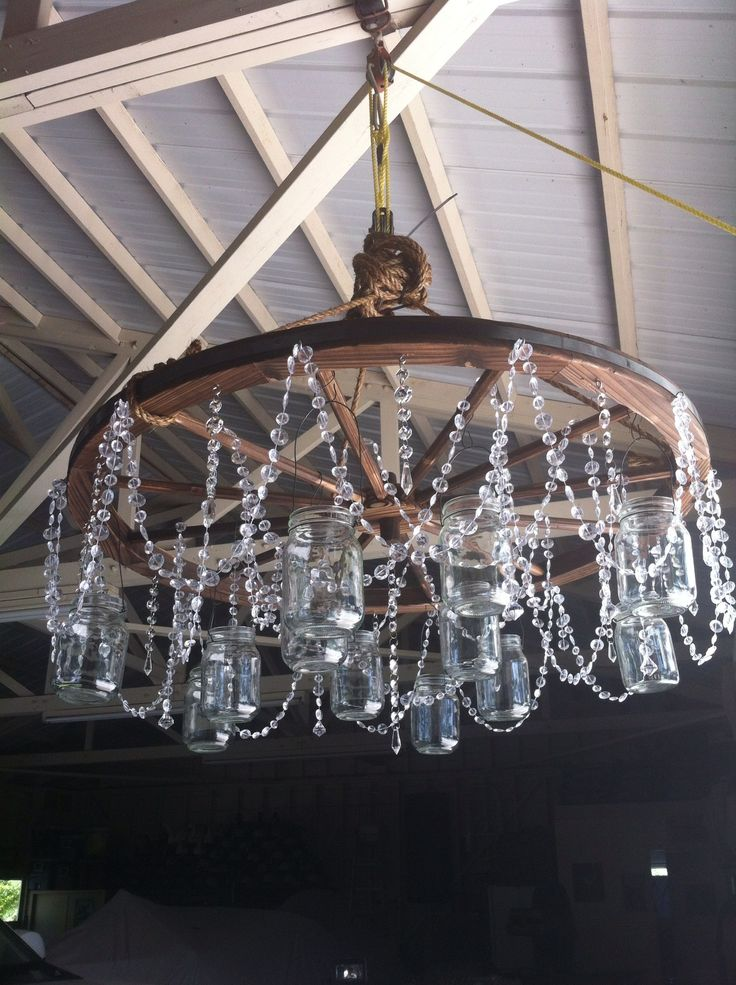 Mason jar and crystal wagon wheel chandelier.