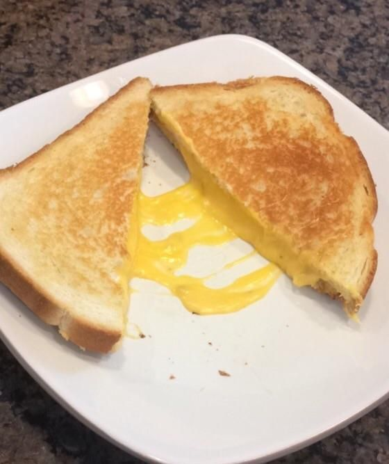 Basic but delish! Country white bread with 3 slices American and 1 slice of Colby jack :) #grilledcheese #food #yum #foodporn #cheese #sandwich #recipe #lunch #foodie