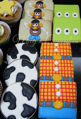 Superheroes Cake and Toy Story Cupcakes and cookies