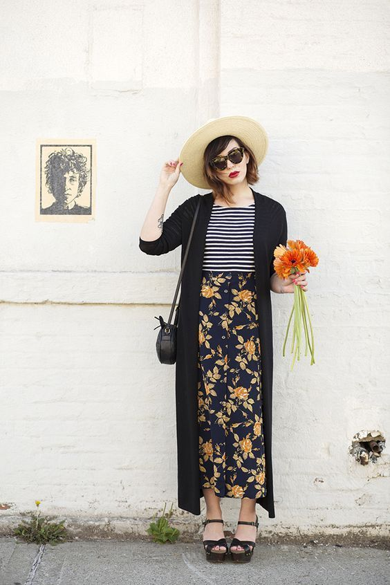 Long cardigan styled with a maxi skirt and a hat