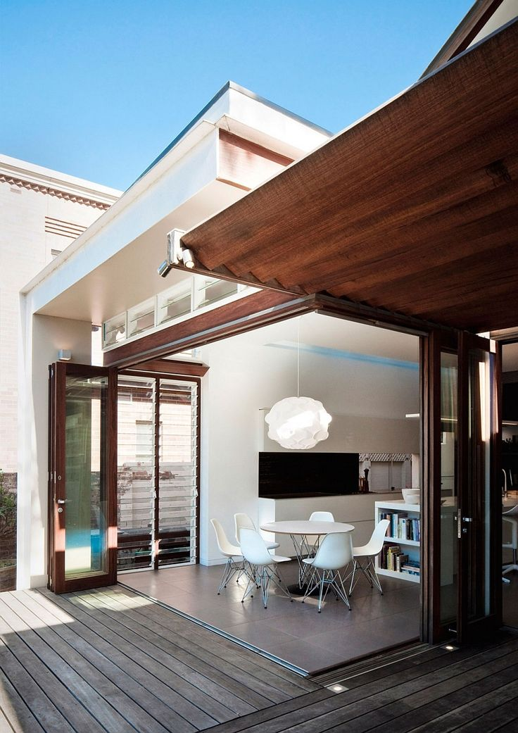 Stylish dining area extends into the backyard