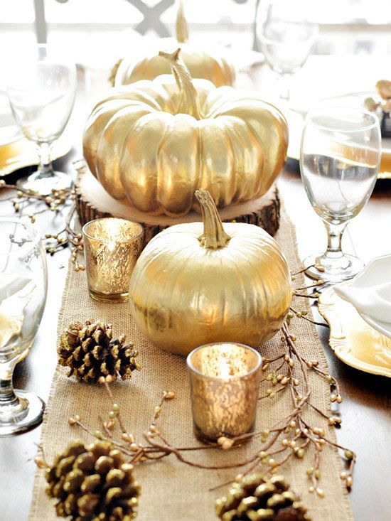 Glitter is a holiday trend that tends to stay in style. Make the most of this easy DIY supply by adding gold to your centerpiece pumpkins, branches, and pinecones. When set on top of a pretty burlap runner, this look feels modern and fresh, yet decidedly rustic. (image credit: Crystal Owens)/