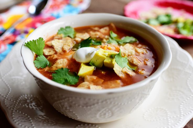 Pioneer Woman Slow Cooker Chicken Tortilla Soup - I added 2 tsp minced garlic & used 3 chipotle peppers. I added 3 Tbsp corn meal mixed with 1/2 cup water at the end to give it a little more corn flavor like Ree's original Chicken Tortilla Soup. Delicious, especially with all the fixings!
