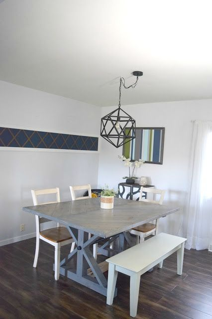 Dining room revamp. This coastal dining room, DIY farmhouse table and new wall art helps this home feel complete. To see more visit- http://ourhousenowahome.com/