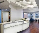 The position of the reception desk provides a strong visual connection to the comfortable and gracious seating area.
