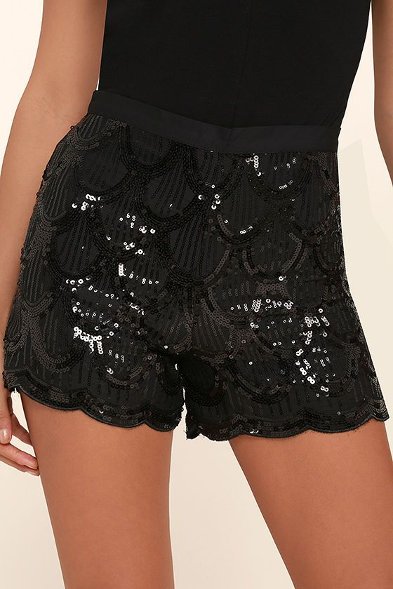 Dance your way through the night in the New York Lights Black Sequin Shorts! Shiny black sequins create a scalloped pattern across these high-waisted shorts with a banded waist and matching scalloped hems. Hidden side zipper/clasp.