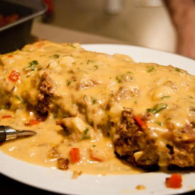 Meatloaf is a classic comfort food dish, and this cheesy sauce poured over is the definition of comfort taken one step farther. Delicious!