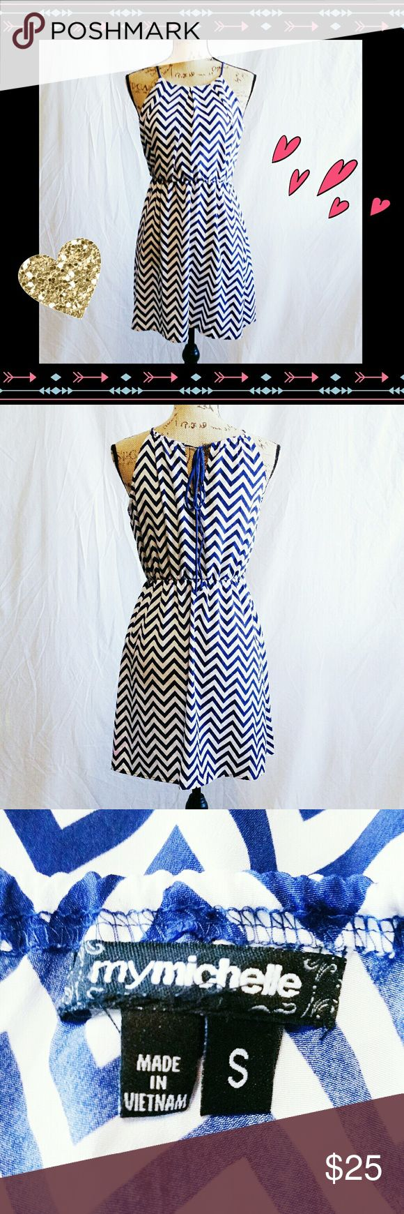 My Michelle Chevron Print Dress - Size S Flirty blue & white chevron print My Michelle strappy midi dress. Adjustable top strap tires over keyhole in back. Bra shelf lining. Excellent used condition. Size Small. 100% polyester. Hand wash cold & line dry. Make an offer! My Michelle Dresses Midi