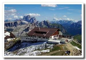 Refugio Laguzoi - Cortina d'Ampezza. You absolutely MUST go here if you are ever in this area of Italy. Spectacular views, great restaurant, you can simply come for dinner (bus ride from Cortina, then gondola up to refugio) or stay over night as the first night of your trek. Don't forget to explore the old war tunnels in the area !