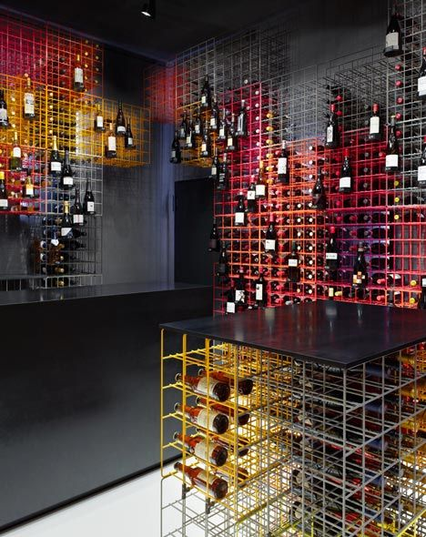 This wine display looks like a 3D interpretation of a 2D diagram I did in my architecture studies - Weinhandlung Kreis by Furch Gestaltung and Production