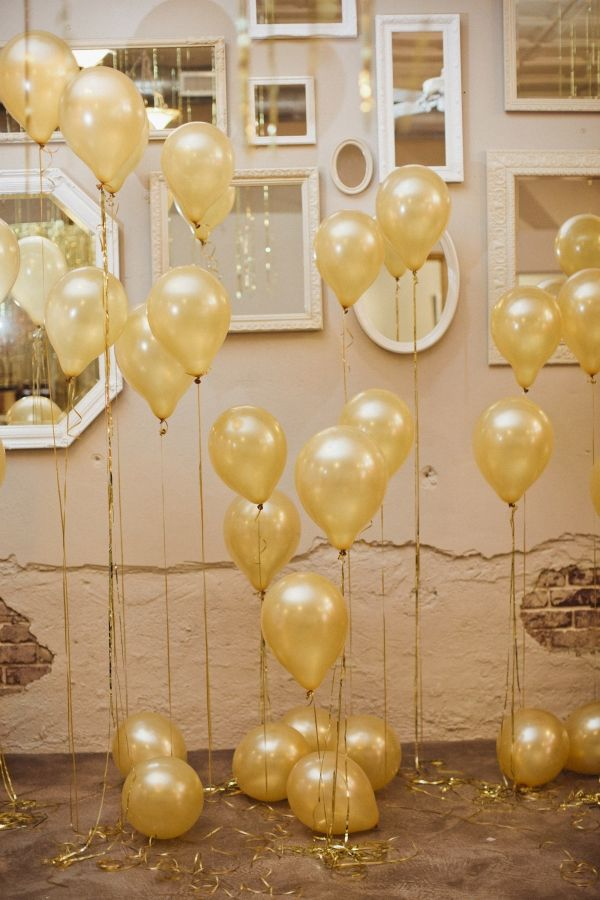 wall of gold balloons and mirrors, photo by Sara & Rocky Photography http://ruffledblog.com/gold-and-pink-valentines-day-shoot #weddingideas #backdrops