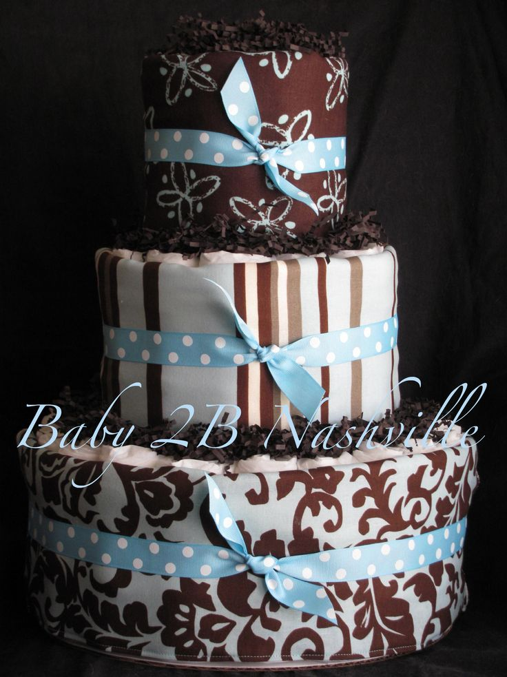 diaper cake in blue and brown damask...Baby Shower Wraps Ideas, Blue Baby, Brown Chocolates, Baby Diaper Cakes, Diapers Cake Cans, Cake Baby, Receiving Blankets, Baby Diapers, Baby Shower