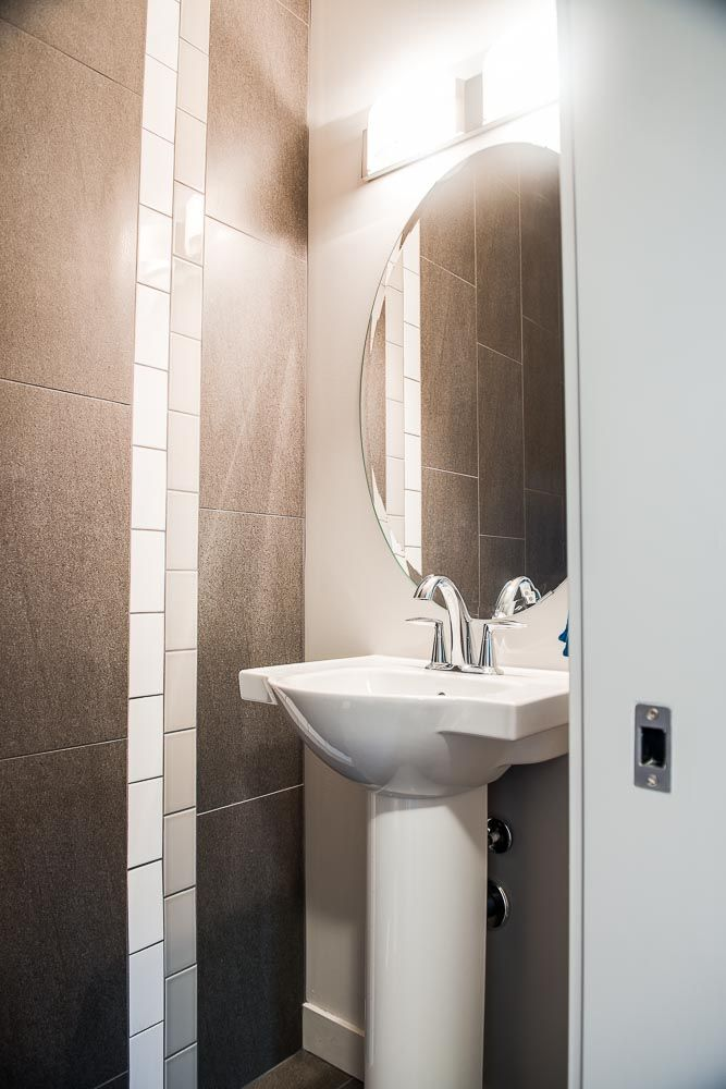 Elegant Powder Room With A Tile Accent Wall Dolce Vita Homes Dover Ii Sh Master Bathroom Remodel Small Small Bathroom Tiles Modern Bathroom Design