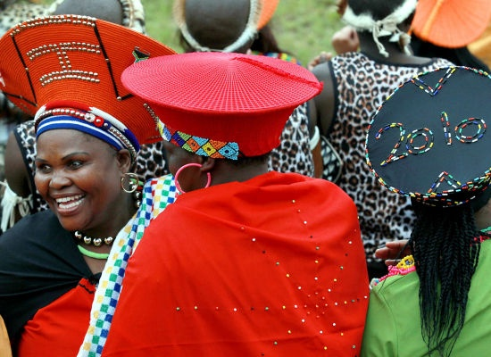 Multiple marriages are commonplace in Zulu culture. These women wear the traditional hat of a married woman.