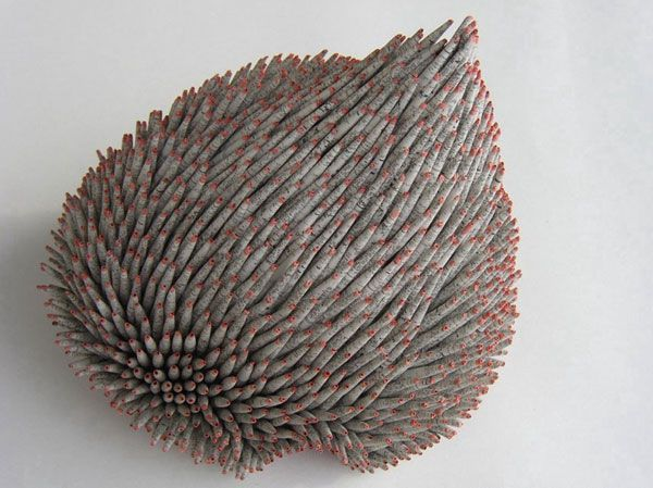 Organic sculptures made with rolled paper by Swiss artist Valérie Buess who lives and works in Germany. For the better part of 20 years she's been working with various forms of paper in both two and three dimensional artworks.