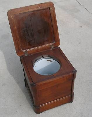 """A """"necessary"""" cabinet! I got one of these from an antique store...when the lid is down it looks like a little end table! It's so unique!"""