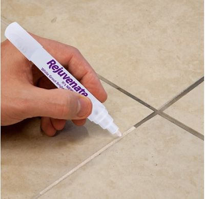Obviously the inventors of this stuff have realized that no amount of scrubbing will clean grout, so painting it becomes the next best option. The pen is like a big white highlighter with a white paint that readily covers the grout.