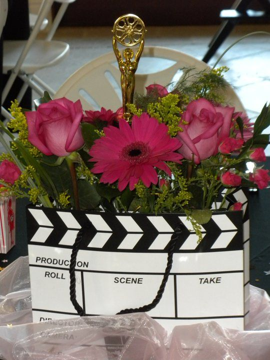 don't really like the movie theme... but i do like the flowers/color for center pieces
