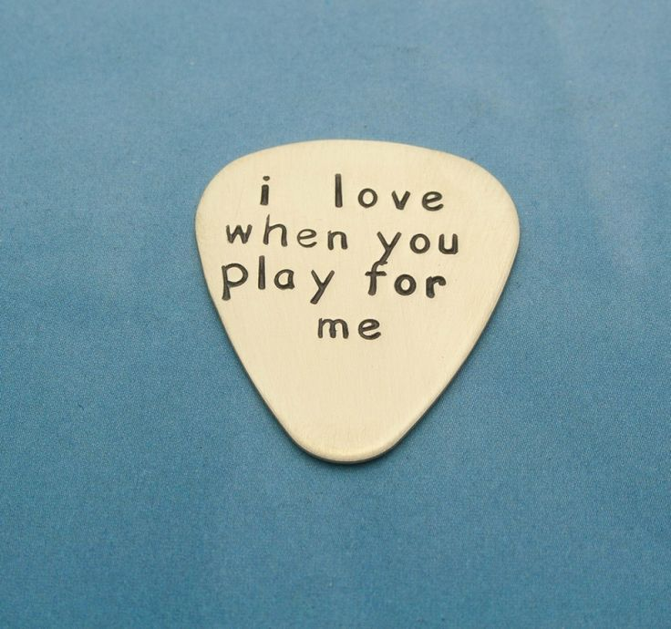 Personalized guitar picks make unique gifts for musicians and music lovers. This hand stamped pick is made of NuGold, which is a brass mixed with a bit of copper. The result is a warmer, truer gold color – gorgeous!