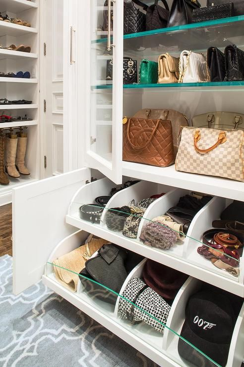 A Bag Cabinet In My New Closet? Built In Bag Cabinets Accented With Glass  Doors Lined With Glass Shelves Placed Over Stacked Pull Out Accessory  Drawers With ...