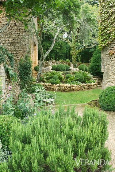 "stone walls and more than 100 boxwoods. ""You discover the garden as you wander through or linger with a glass of wine,"" he says. ""It's another way of reflecting on life and experiencing what the French callsavoir vivre."" French 19th-century sphinxes overlook the garden.   - Veranda.com"