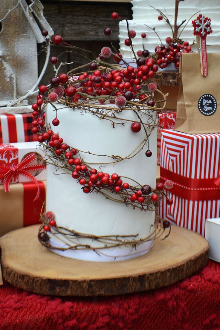 Rustic berry and twig cake on a wood riser. By Bake Sale.