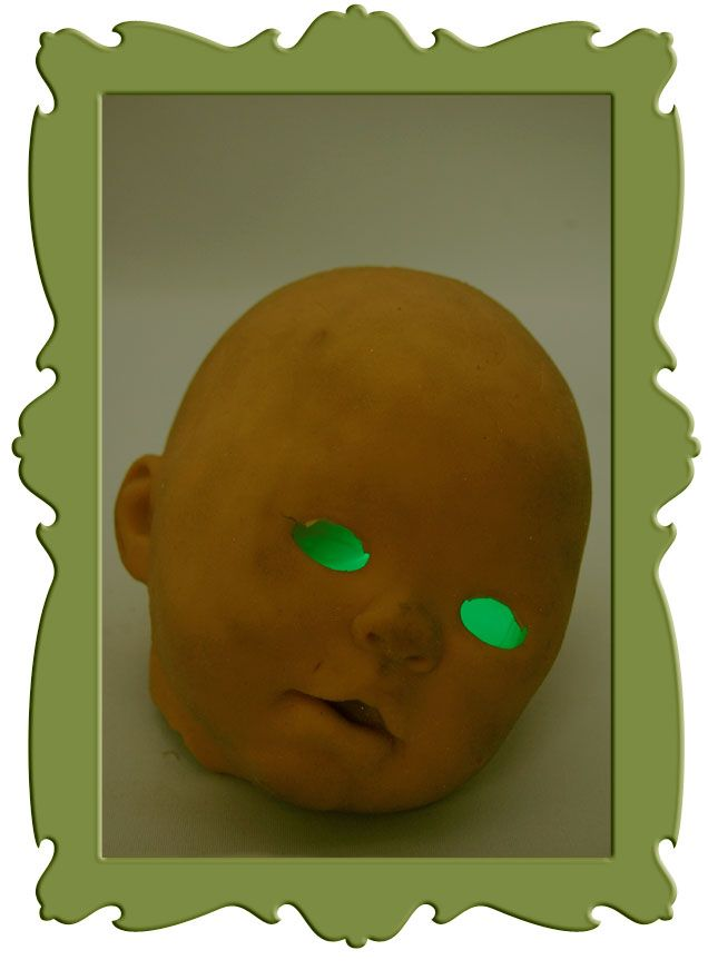 creepiest Halloween decoration ever.  Doll's head and a glowstick.
