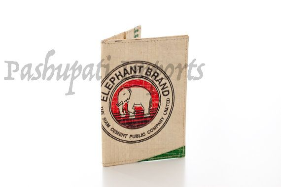 This is a very novel passport cover that will be a real conversation starter. It has a neat elephant design in red, black white and green. Hand