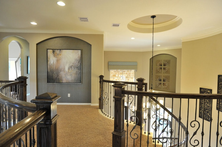 Village Builders - Houston,TX - Kingston Model Home. Ballastrade not my personal taste but like the floating 'hallway' concept