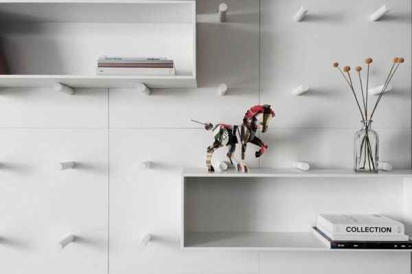 Simple Wall that Features Modular Shelving System – Dots. This lets you modify and change things around as you wish.