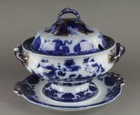 """Lot No 90 A Victorian blue and white tureen cover and stand with gilt decoration 12"""", sold for £300"""