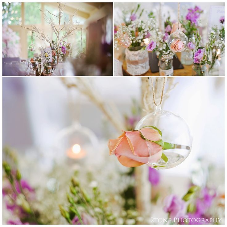 Hanging rose wedding reception table centres