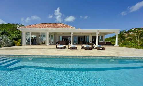 Located in the gated Baie Rouge Residence, this air-conditioned, beachfront property is gorgeous, with astonishing views where the turquoise Caribbean waters and the clear blue sky are separated only by the island of Anguilla in the far horizon.