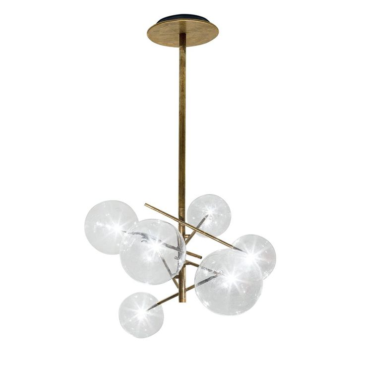 Hanging lamp with halogen point light (120 Watt). 6 transparent blown glass spheres. Available also version with 4 spheres (80 Watt). Metal parts in hand burnished brass.The hand burnished brass finish looks naturally spotted and irregular. Due to this craft made processing, each product is unique and exclusive. Dimmable light. The height can be customised from a minimum of 85cm (Bolle 6) and 73 cm(Bolle 4) to a maximum of 600 cm (including lights). LED version, upon request.