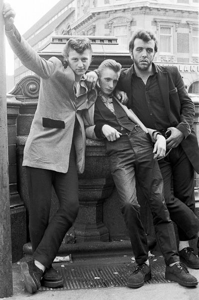 The States had the Rockers - Levi's, t-shirts, switchblades, pompadours. The Brits had the Teddy Boys - Edwardian drape coats, brothel creepers, razors blades, and quiffs.